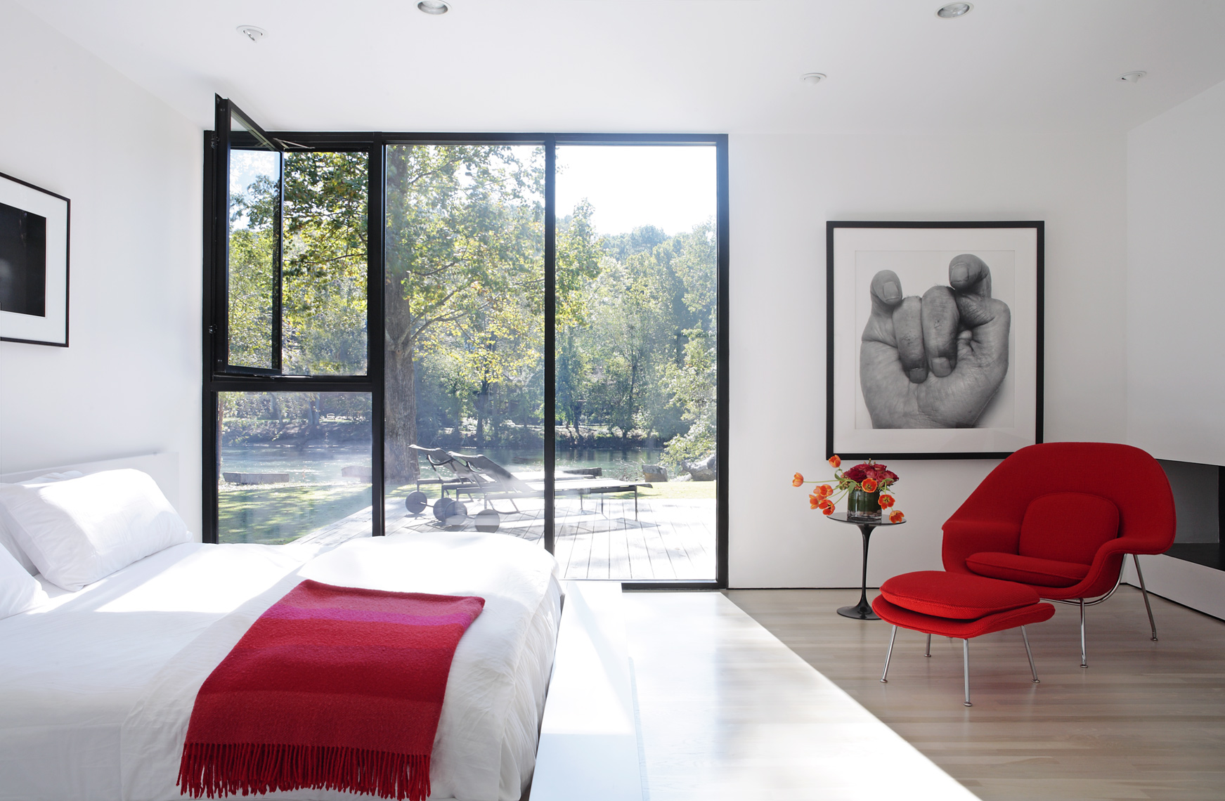 Mali Azima inteiors modern bedroom with Knoll Womb Chair.jpg
